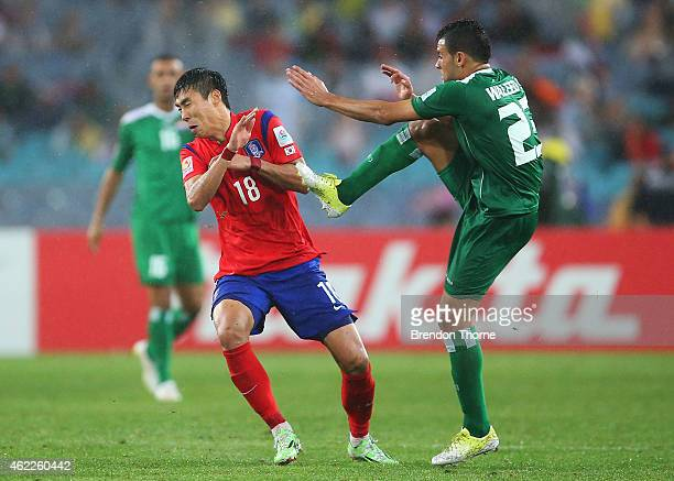 Lee Jeonghyeop of Korea Republic reacts after a high boot from Waleed Salim AlLami of Iraq during the Asian Cup Semi Final match between Korea...