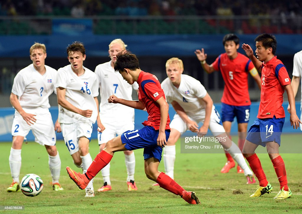Lee Jiyong of Korea Republic shoots during the 2014 FIFA Boys Summer Youth Olympic Football Tournament Semi Final match between Korea Republic and Iceland at Jiangning Sports Centre Stadium on August 24, 2014 in Nanjing, China.
