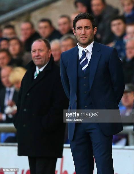 Lee Johnson the manager of Oldham Athletic and his father Gary Johnson the manager of Yeovil Town look on during the npower League One match between...