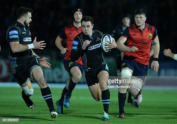 Lee Jones of Glasgow Warriors breaks free of the Munster defence during the European Rugby Champions Cup match between Glasgow Warriors and Munster...