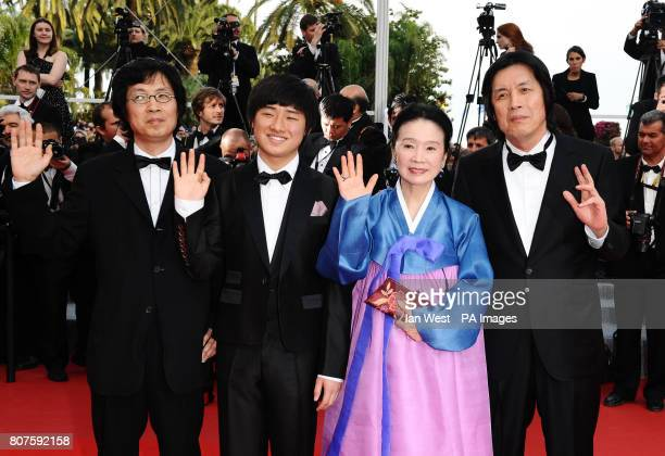 Lee Joondong Lee David Yun Junghee and Lee Changdong arrive for the premiere of Poetry at the Palais de Festival in Cannes France