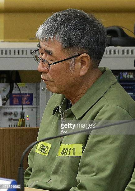 Lee JoonSeok the captain of the sunken South Korean ferry Sewol sits for verdicts as the ship's crew members are charged with negligence and...