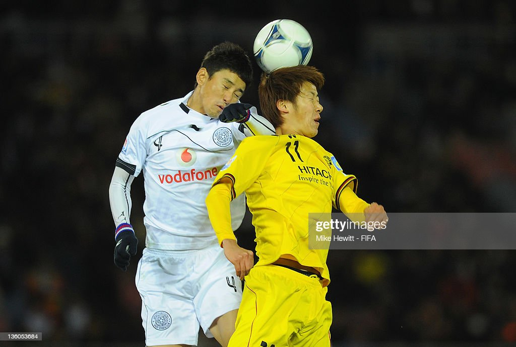 Lee Jung Soo of Al-Sadd (L) challenges Ryohei Hayashi of Kashiwa Reysol in the air during the FIFA Club World Cup 3rd Place Match between Kashiwa Reysol and Al-Sadd Sports Club at the Yokohama International Stadium on December 18, 2011 in Yokohama, Japan.