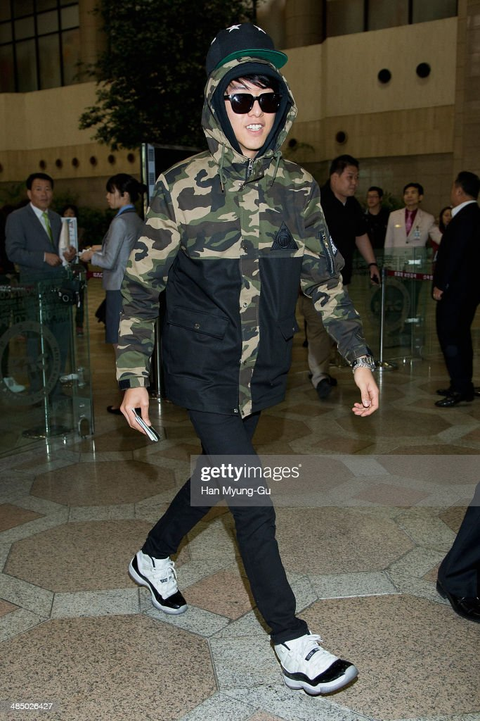 Lee JungShin of South Korean boy band CNBLUE is seen on departure at Gimpo International Airport on April 15 2014 in Seoul South Korea