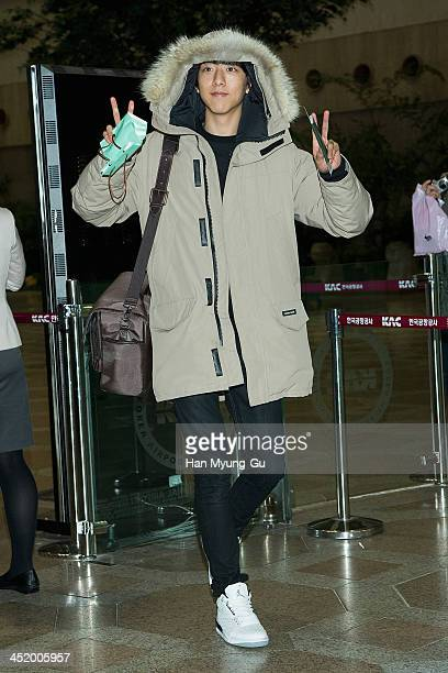 Lee JungShin of South Korean boy band CNBLUE is seen upon arrival at the Gimpo International Airport on November 25 2013 in Seoul South Korea