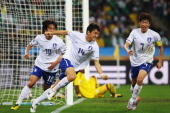 Lee JungSoo of South Korea celebrates scoring the equalising goal against Nigeria during the 2010 FIFA World Cup South Africa Group B match between...
