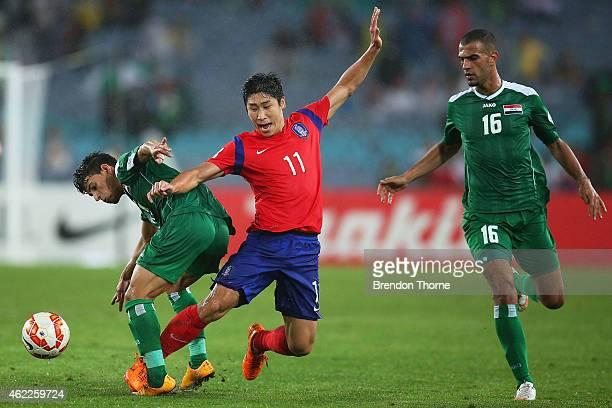 Lee Keun Ho of Korea Republic competes with Mahdi Kamil Shiltagh of Iraq during the Asian Cup Semi Final match between Korea Republic and Iraq at ANZ...