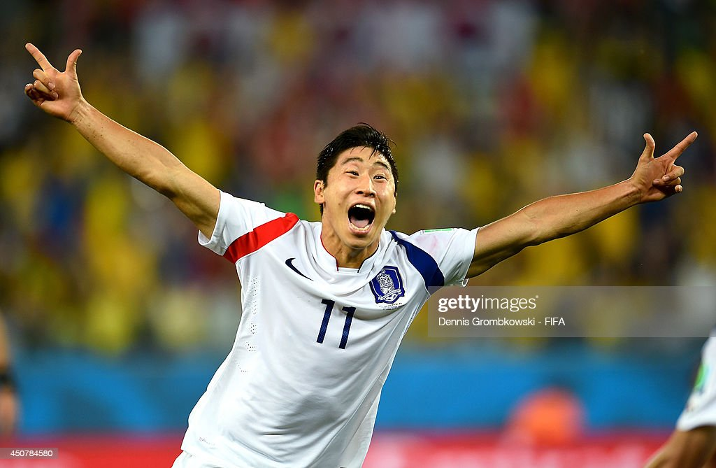 Lee Keun-Ho of South Korea celebrates after scoring the team's first goal during the 2014 FIFA World Cup Brazil Group H match between Russia and Korea Republic at Arena Pantanal on June 17, 2014 in Cuiaba, Brazil.