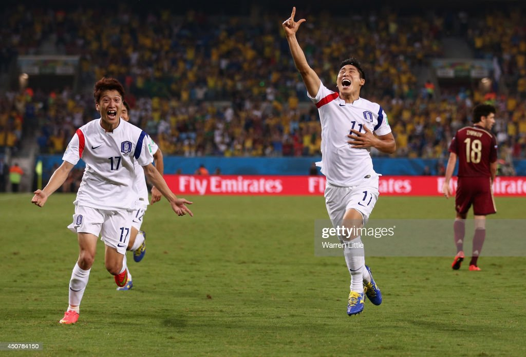 Lee Keun-Ho of South Korea (R) celebrates scoring his team's first goal during the 2014 FIFA World Cup Brazil Group H match between Russia and South Korea at Arena Pantanal on June 17, 2014 in Cuiaba, Brazil.