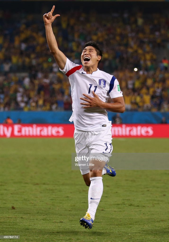 <a gi-track='captionPersonalityLinkClicked' href=/galleries/search?phrase=Lee+Keun-Ho&family=editorial&specificpeople=4435767 ng-click='$event.stopPropagation()'>Lee Keun-Ho</a> of South Korea celebrates scoring his team's first goal during the 2014 FIFA World Cup Brazil Group H match between Russia and South Korea at Arena Pantanal on June 17, 2014 in Cuiaba, Brazil.