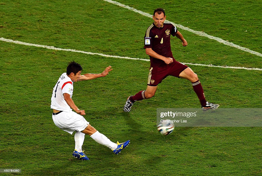 Lee Keun-Ho of South Korea shoots and scores his team's first goal during the 2014 FIFA World Cup Brazil Group H match between Russia and South Korea at Arena Pantanal on June 17, 2014 in Cuiaba, Brazil.