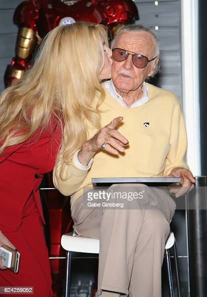 C Lee kisses her father comic book icon Stan Lee at Marvel Avengers STATION at the Treasure Island Hotel Casino on November 18 2016 in Las Vegas...