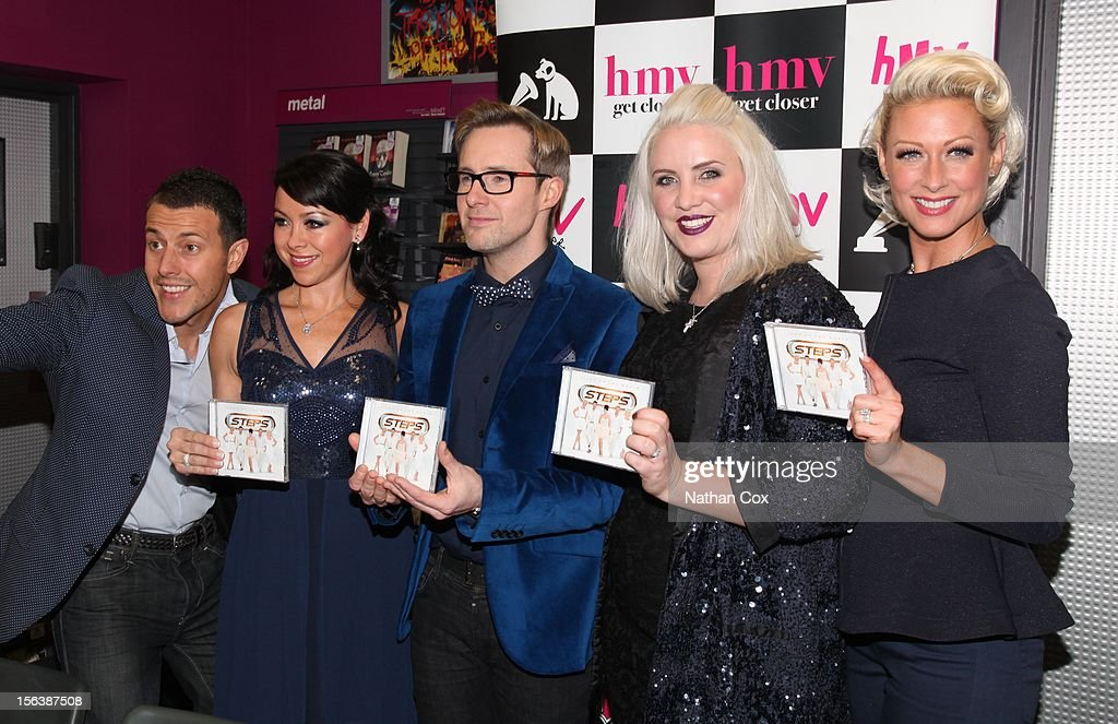 Lee Latchford-Evans, Lisa Scott-Lee, Ian 'H' Watkins, Claire Richards and Faye Tozer of Steps meet fans and sign copies of their album 'Light Up The World' on November 14, 2012 in Stockport, England.