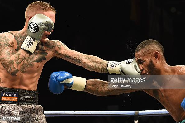 Lee Markham throws a left hand punch against on Andrew Robinson during the English middleweight title fight at Brentwood Centre on November 25 2016...