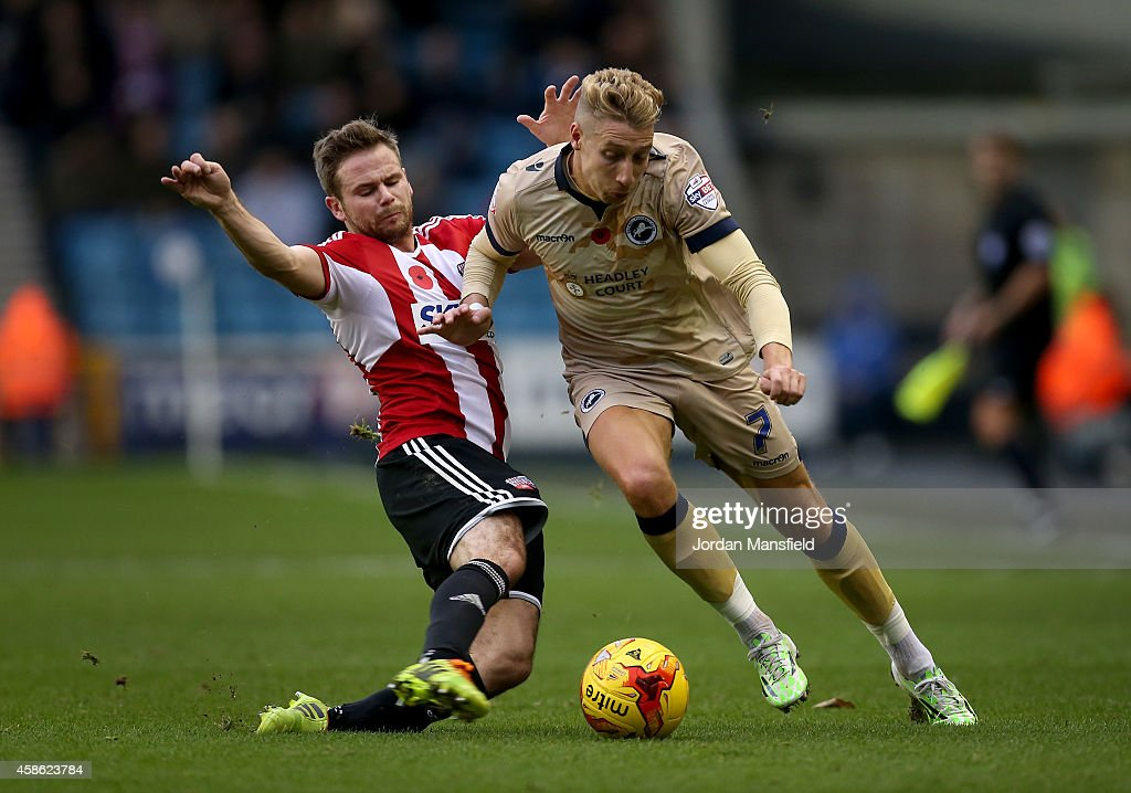 Lee Martin of Millwall tackles with Alan Judge of Brentford during the Sky Bet Championship match between Millwall and Brentford at The Den on November 8, 2014 in London, England.