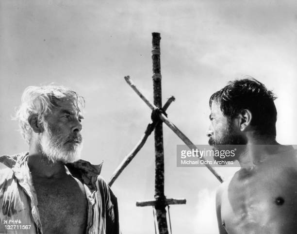 Lee Marvin and Toshiro Mifune confront each other in a tense moment as they prepare to face the unknown dangers together about the crude raft theyve...