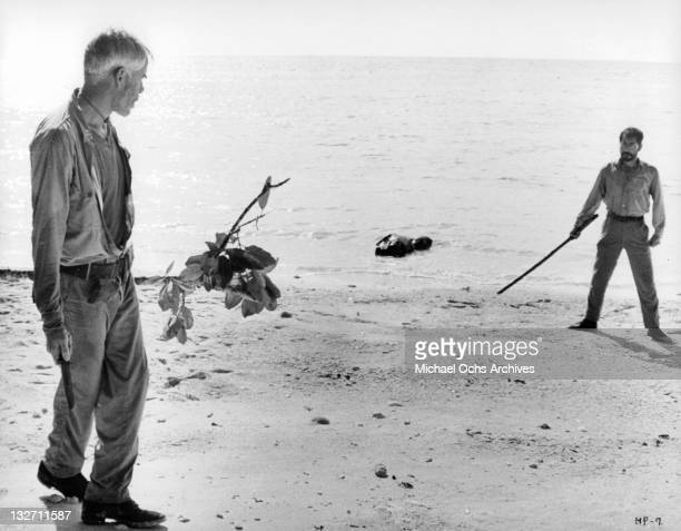 Lee Marvin and Toshiro Mifune face off on the beach in a scene for the film 'Hell In The Pacific' 1968