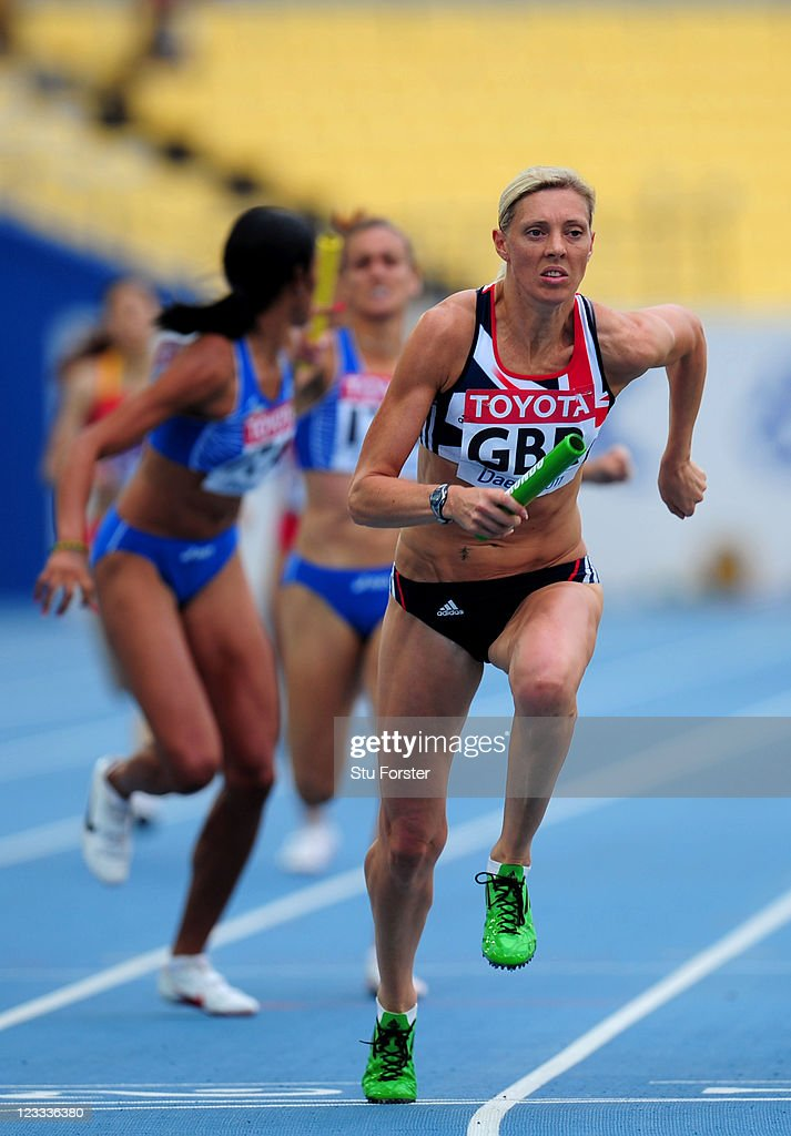 <a gi-track='captionPersonalityLinkClicked' href=/galleries/search?phrase=Lee+McConnell&family=editorial&specificpeople=162784 ng-click='$event.stopPropagation()'>Lee McConnell</a> of Great Britain competes during the women's 400 metre relay heats during day seven of 13th IAAF World Athletics Championships at Daegu Stadium on September 2, 2011 in Daegu, South Korea.
