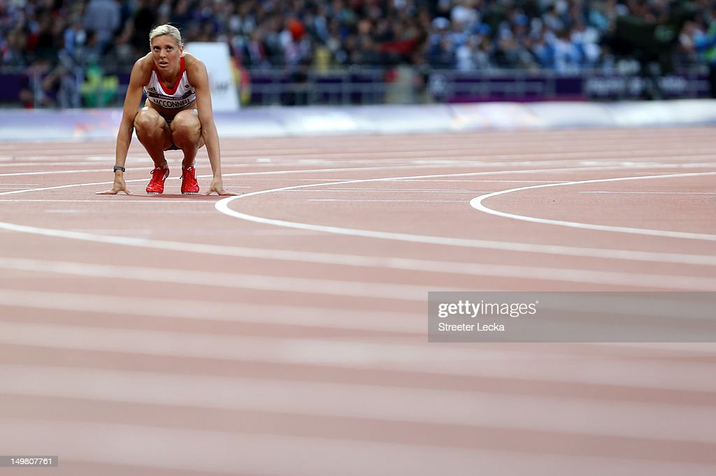 <a gi-track='captionPersonalityLinkClicked' href=/galleries/search?phrase=Lee+McConnell&family=editorial&specificpeople=162784 ng-click='$event.stopPropagation()'>Lee McConnell</a> of Great Britain reacts after competing in the Women's 400m Semi Final on Day 8 of the London 2012 Olympic Games at Olympic Stadium on August 4, 2012 in London, England.
