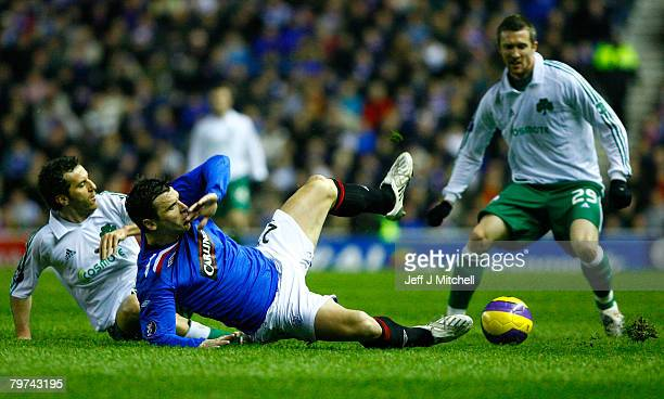 Lee McCulloch of Rangers is tackled by Ioannis Goumas of Panathinaikos during the UEFA Cup round of 32 first leg match at Ibrox Stadium February 13...