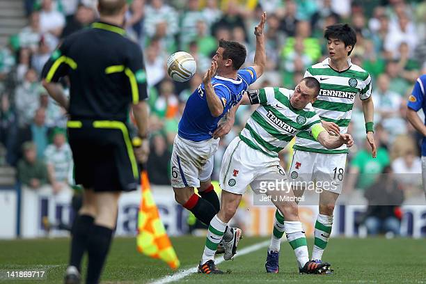 Lee McCulloch of Rangers tackles Scott Brown of Celtic during the Scottish Clydesdale Bank Scottish Premier League match between Rangers and Celtic...