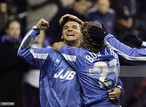 Lee McCulloch of Wigan Athletic is congratulated by team mate Jimmy Bullard after scoring the second goal during the CocaCola Championship match...