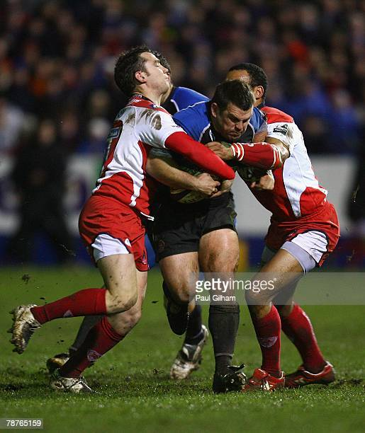 Lee Mears of Bath is tackled by Ryan Lamb and James Bailey of Gloucester during the Guinness Premiership match between Bath Rugby and Gloucester at...