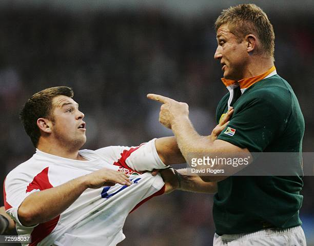 Lee Mears of England is confronted by Johan Ackermann of South Africa during the Investec Challenge match between England and South Africa at...