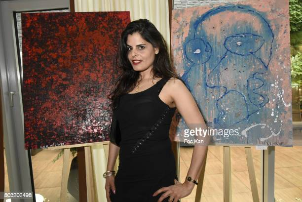 Lee Michel poses with her work during the Dimensions Lee Michel Exhibition Preview at Hotel Rennaissance on June 28 2017 in Paris France