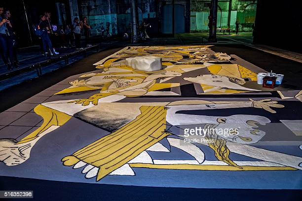 ISLAND SYDNEY NSW AUSTRALIA Lee Mingwei recreates Picasso's Guernica completely in coloured sand taking up 10 m x 5 m on the floor at Carriageworks...