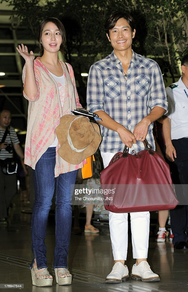 Lee MinJung and Lee ByungHun arrive for their Honeymoon at Incheon International Airport on August 12 2013 in Incheon South Korea