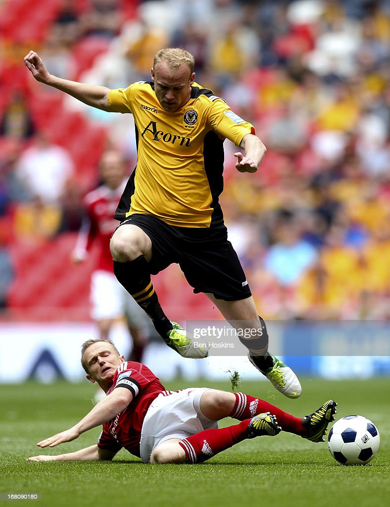 Lee Minshull of Newport is tackled by Dean Keates of Wrexham during the Blue Square Bet Premier Conference Play-off Final match between Wrexham and Newport County A.F.C at Wembley Stadium on May 05, 2013 in London, England.