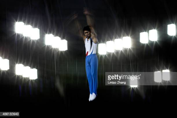 Lee Minwoo of South Korea competes in the Gymnastics Trampoline Men's Final in day seven of the 2014 Asian Games at Namdong Gymnasium on September 26...