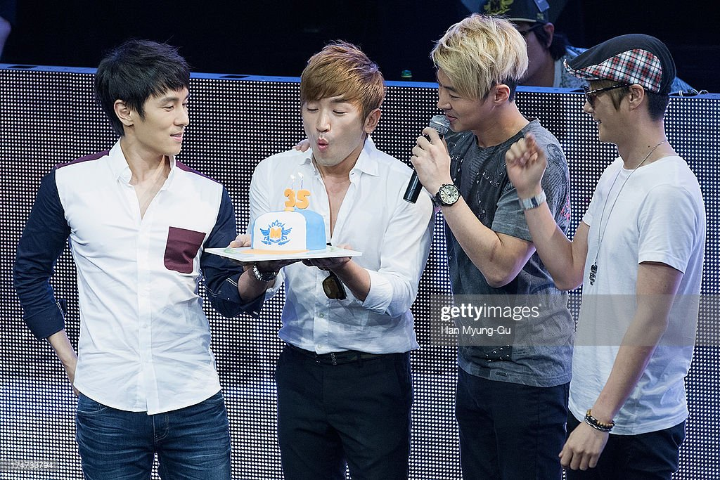 <a gi-track='captionPersonalityLinkClicked' href=/galleries/search?phrase=Lee+Min-Woo&family=editorial&specificpeople=4476484 ng-click='$event.stopPropagation()'>Lee Min-Woo</a> (2nd L) of South Korean boy band Shinhwa blows out the candles on his 35th birthday cake during a promotional event for the 'Wolf-M' Launch Party at Club Ellui Store on July 28, 2013 in Seoul, South Korea.