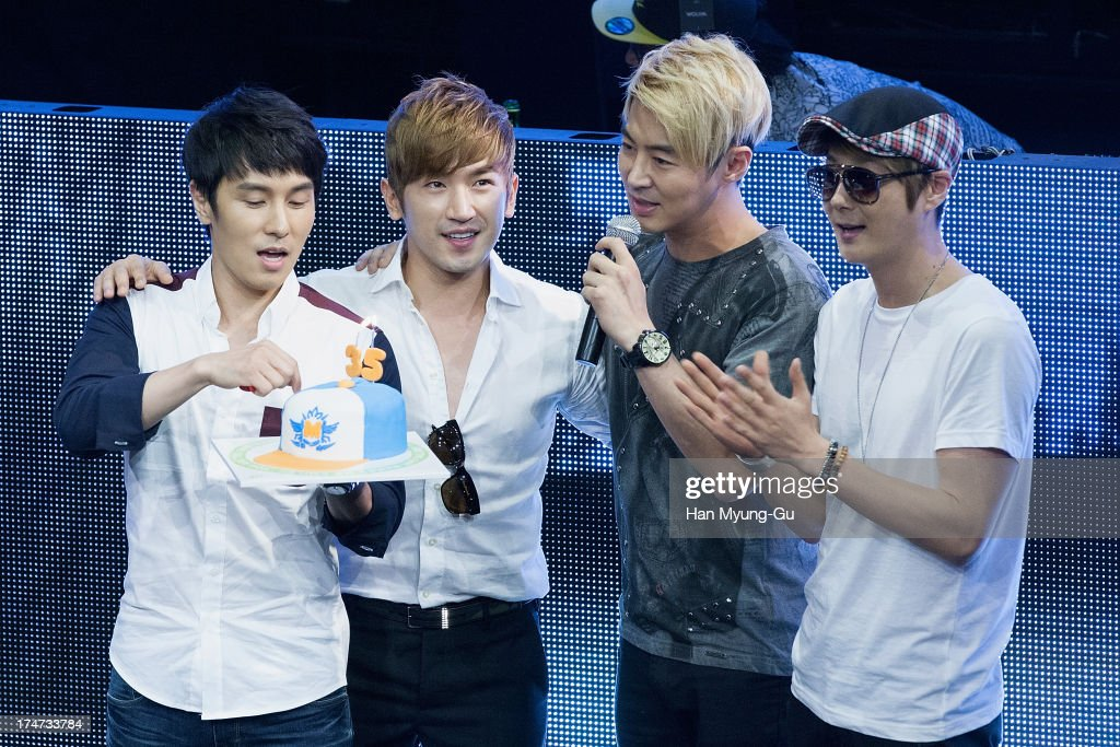 <a gi-track='captionPersonalityLinkClicked' href=/galleries/search?phrase=Lee+Min-Woo&family=editorial&specificpeople=4476484 ng-click='$event.stopPropagation()'>Lee Min-Woo</a> (2nd L) of South Korean boy band Shinhwa cuts his 35th birthday cake during a promotional event for the 'Wolf-M' Launch Party at Club Ellui Store on July 28, 2013 in Seoul, South Korea.