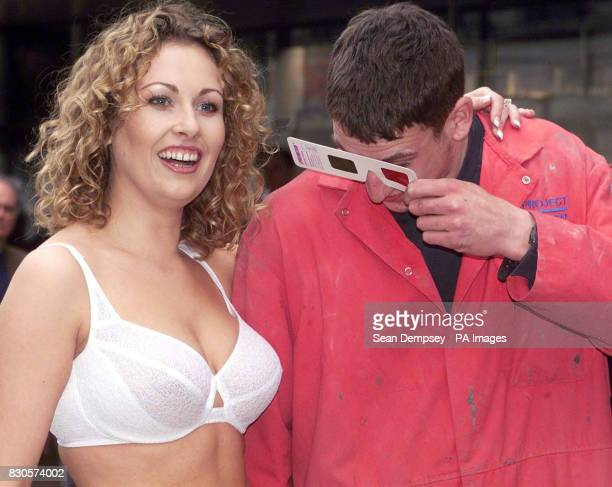 Lee Mountfield looks through 3D glasses at model Ruth Anderson in London's Oxford Street who is wearing Charnos' Bioform Bra at the launch of the...