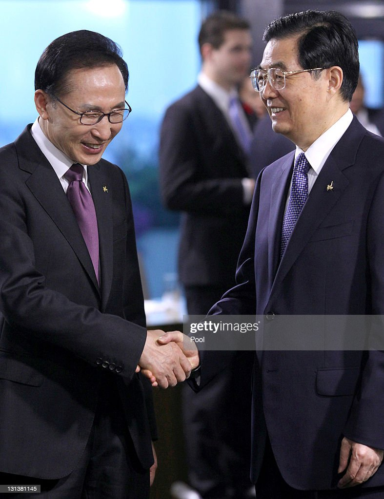 Lee Myung-bak, South Korea's president (L) shakes hands with Hu Jintao, China's president ahead of a working session on the second day of the G20 Summit on November 4, 2011 in Cannes, France. World's top economic leaders are attending the G20 summit in Cannes on November 3rd and 4th, and are expected to debate current issues surrounding the global financial system in the hope of fending off a global recession and finding an answer to the Eurozone crisis.