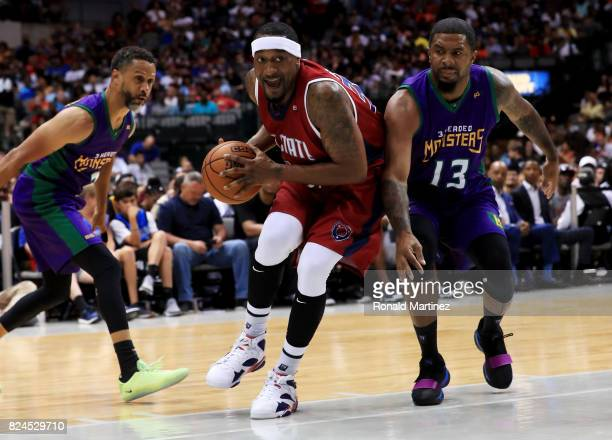 Lee Nailon of TriState dribbles the ball between Mahmoud AbdulRauf and Eddie Basden of the 3 Headed Monsters during week six of the BIG3 three on...