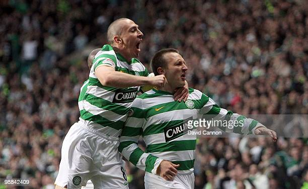 Lee Naylor and Scott Brown of Celtic celebrate Naylor scoring Celtic's first goal during the Clydesdale Bank Scottish Premier League match between...