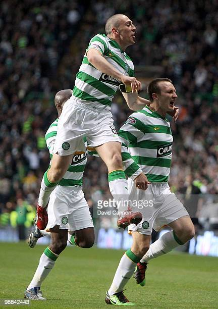 Lee Naylor of Celtic is pursued by Scott Brown as they celebrate Naylor scoring Celtic's first goal during the Clydesdale Bank Scottish Premier...