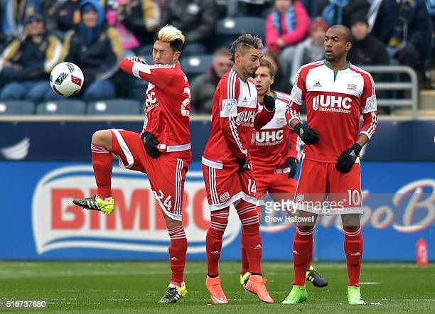 Lee Nguyen Diego Fagundez and Teal Bunbury of New England Revolution react to the ball on a direct kick by the Philadelphia Union in the first half...