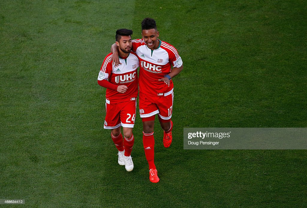 Lee Nguyen of New England Revolution celebrates his penalty kick goal against the Colorado Rapids in the 54th minute with teammate Juan Agudelo of...
