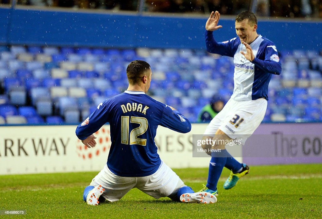 Lee Novak of Birmingham celebrates with teammate Paul Caddis after scoring the opening goal during the FA Cup fourth round match between Birmingham...