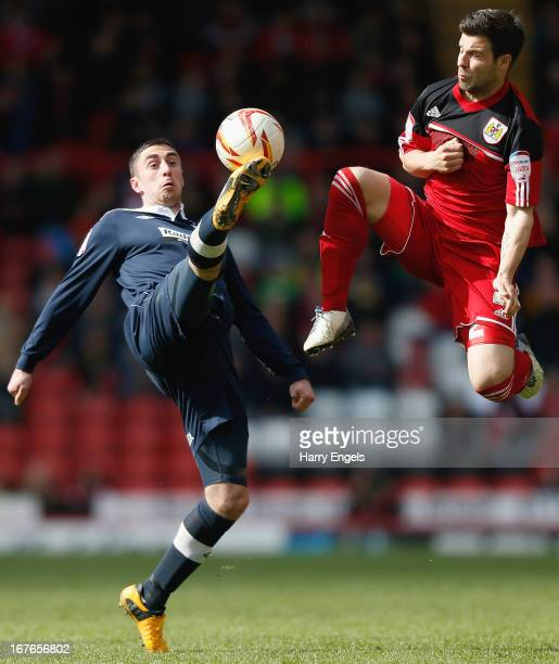 Lee Novak of Huddersfield Town gets to the ball ahead of Richard Foster of Bristol City during the npower Championship match between Bristol City and...