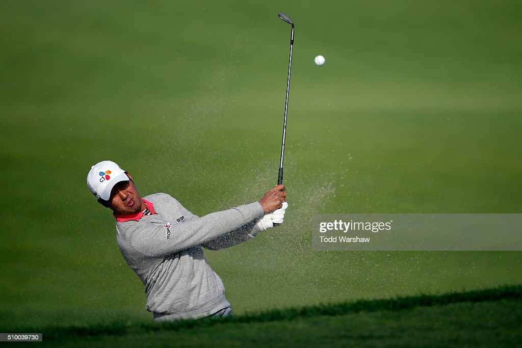 D.H. Lee of Korea plays a shot from the bunker near the 10th green during round three of the AT&T Pebble Beach National Pro-Am at Monterey Peninsula Country Club (Shore Course) on February 13, 2016 in Pebble Beach, California.