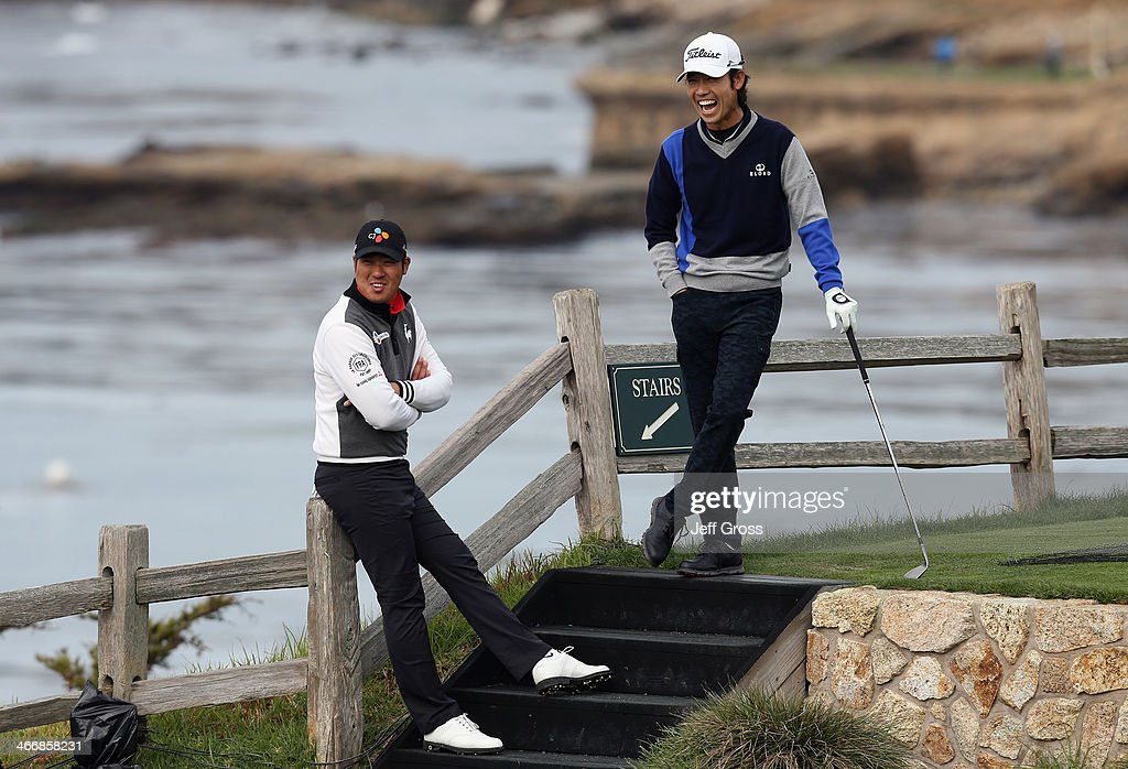 D.H. Lee of South Korea (L) and <a gi-track='captionPersonalityLinkClicked' href=/galleries/search?phrase=Kevin+Na&family=editorial&specificpeople=235605 ng-click='$event.stopPropagation()'>Kevin Na</a> share a laugh on the seventh hole during a practice round for the AT&T Pebble Beach National Pro-Am at Pebble Beach Golf Links on February 4, 2014 in Pebble Beach, California.