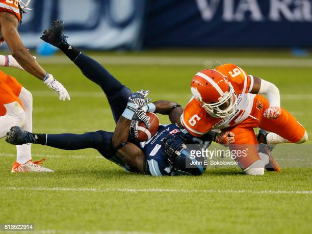 J Lee of the BC Lions hits SJ Green of the Toronto Argonauts after a catch during a CFL game at BMO field on June 30 2017 in Toronto Ontario Canada...