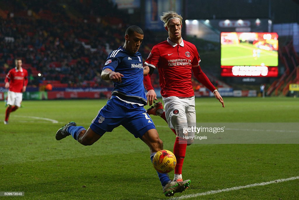 Lee Peltier of Cardiff clears the ball under pressure from Simon Makienok of Charlton during the Sky Bet Championship match between Charlton Athletic and Cardiff City at The Valley on February 13, 2016 in London, United Kingdom.
