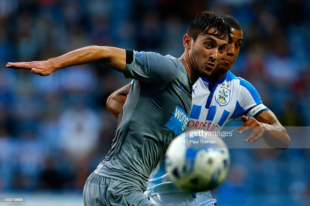 <a gi-track='captionPersonalityLinkClicked' href=/galleries/search?phrase=Lee+Peltier&family=editorial&specificpeople=1007594 ng-click='$event.stopPropagation()'>Lee Peltier</a> (R) of Huddersfield in action with <a gi-track='captionPersonalityLinkClicked' href=/galleries/search?phrase=Facundo+Ferreyra&family=editorial&specificpeople=7451876 ng-click='$event.stopPropagation()'>Facundo Ferreyra</a> of Newcastle during the Pre Season Friendly match between Huddersfield Town and Newcastle United at the John Smith's Stadium on August 5, 2014 in Huddersfield, England.