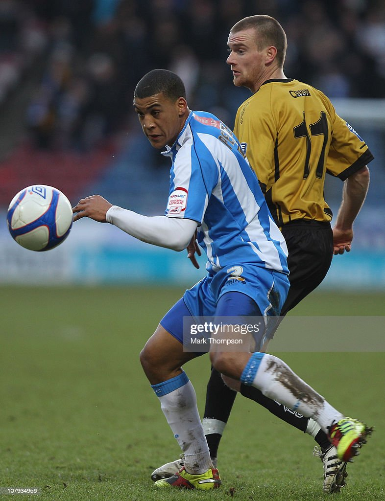 <a gi-track='captionPersonalityLinkClicked' href=/galleries/search?phrase=Lee+Peltier&family=editorial&specificpeople=1007594 ng-click='$event.stopPropagation()'>Lee Peltier</a> of Huddersfield Town (L) in action against Barry Cogan of Dover Athletic during the FA Cup sponsored by E.ON third round match between Huddersfield Town and Dover Athletic at Galpharm Stadium on January 8, 2011 in Huddersfield, England.
